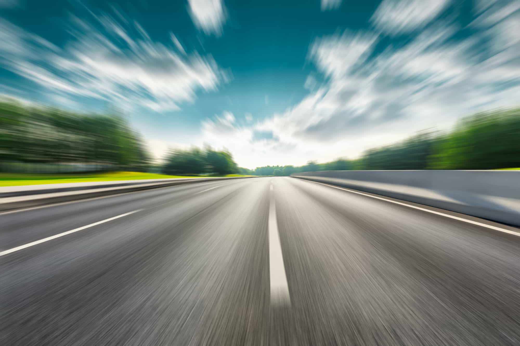 Photo of Road from view of vehicle driving fast